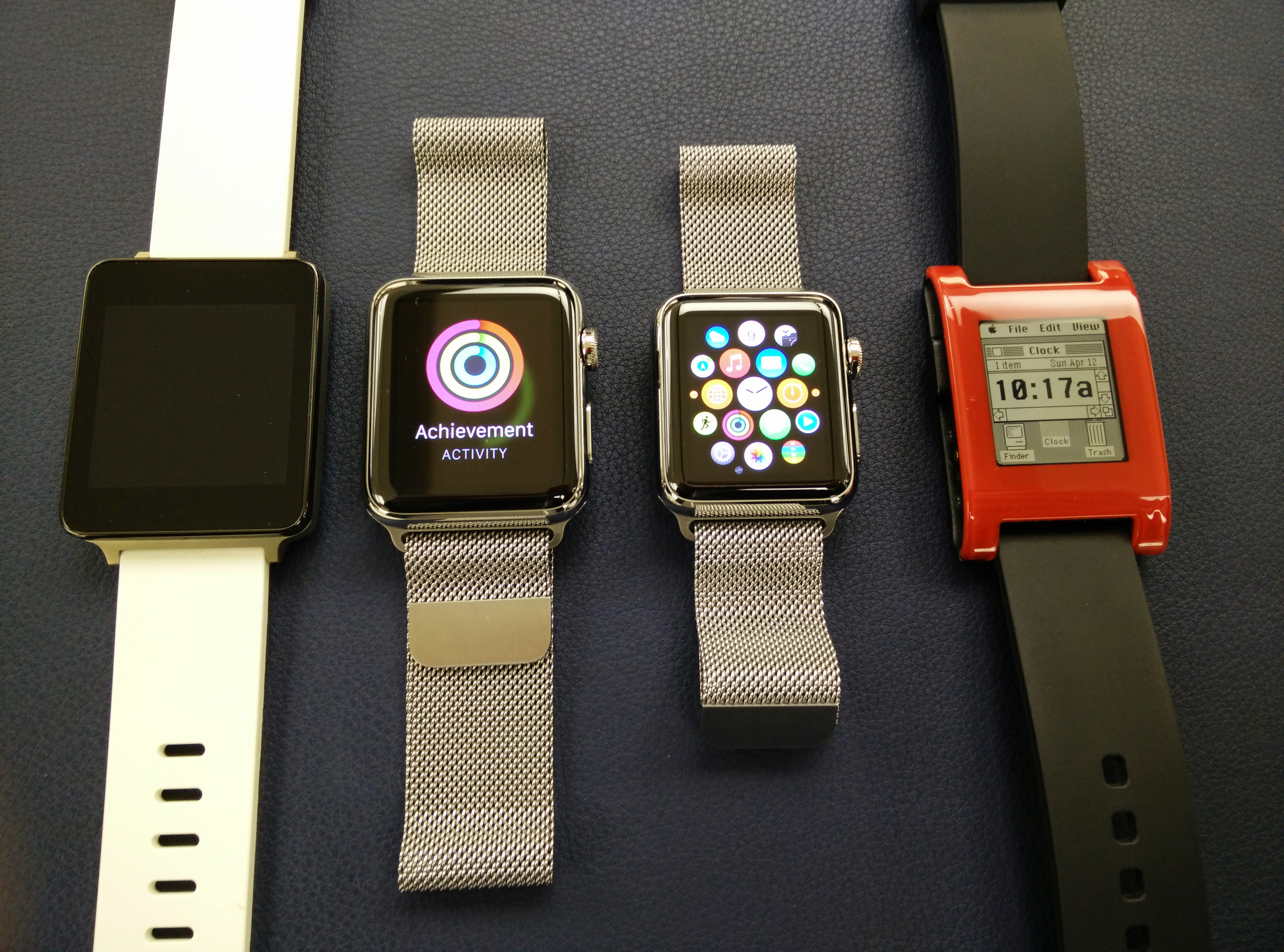 Apple Watches Flanked by Android Wear and Pebble