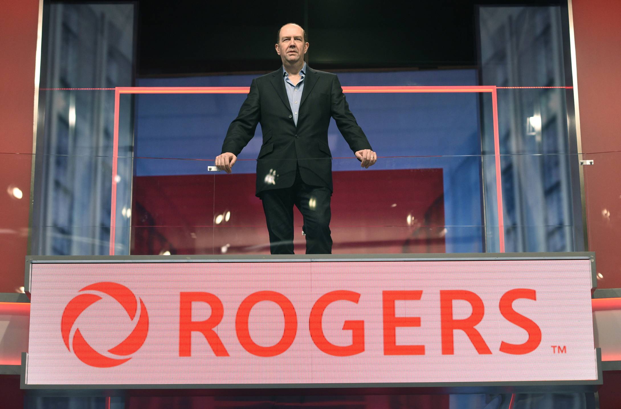 Guy Laurence with Oversized Rogers Logo